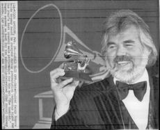 "Kenny Rogers receives a Grammy for ""The Gambler""."