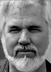 Portrait image of American singer Kenny Rogers.