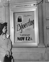 Girl looking at poster of Jussi Björling.