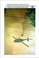 A helicopter releases 300 gallons of water over a fire in Volusia County