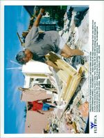 The devastation of Jarrell after the tornado. Ruben Ramirez helps his friend George Clark with the waste of his house