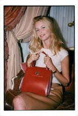 Claudia Schiffer at a fashion show of handbags for Bulgari and UNICEF
