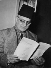 Portrait of Egyptian journalist, writer and poet Abbas al-Aqqad while he reading a book