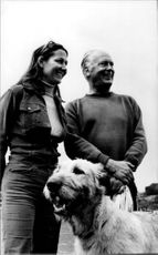 Curd Jürgens smiling with woman.