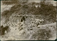 Soldiers siting and having conversation in Liaojang, 1904.