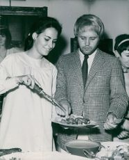 Mark Slade with his wife Melinda Riccilli, serving food.