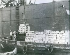 Crates of American food shown being unloaded from a British freighter at Malta.