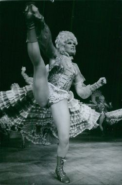 A man in his costume performs on stage in Paris.