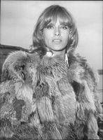 Portrait image of actress Nathalie Delon taken when she arrives at Heathrow from Paris.
