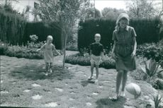 Prince Albert II's family playing in the garden with a ball.