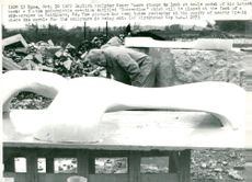 """Sculptor Henry Moore looks at a model of his work """"Conception"""""""