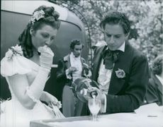 """A scene from the film """"Every heart has its story"""" casting by Henrik Schildt, Kenne Fant, with Inger Juel, 1948."""