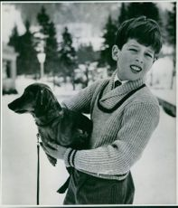 Alexander, Crown Prince of Yugoslavia, holding his dog.