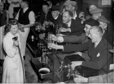 The waitress Nancy Goulden holds up the new beer gun at the bar at the North Eastern Hotel - 16 August 1949