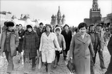 Group of tourists on the Red Square in Moscow.