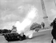 Army tank leaving spark and smoke in one of the scenes of a film.