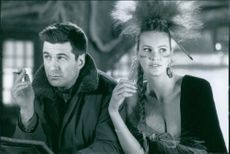 Alec Baldwin and Elle Macpherson in a scene from the film The Edge, 1997.