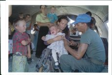 The Rwandan War:A french UN doctor inoculates children.
