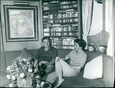 Stavros Niarchos sitting and talking along with Eugenia Livanos.