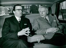West German Foreign Minister , Walter Scheel, with Karl Guenther von Hase, West German Ambassador to the United Kingdom, talking inside the car, in London, 1970.