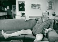 Actor Carl-Gustaf Lindstedt on the couch at home