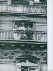Women standing on the balcony and looking down.