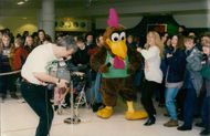 FLASHBACK TO THE FILMING OF THE CHICKEN TONIGHT COMMERCIALS IN CASTLE MALL