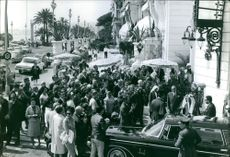 Press people, men and women gathered in front of the service car for King Saud as they want to have a word or pictured of him on his visit in France.