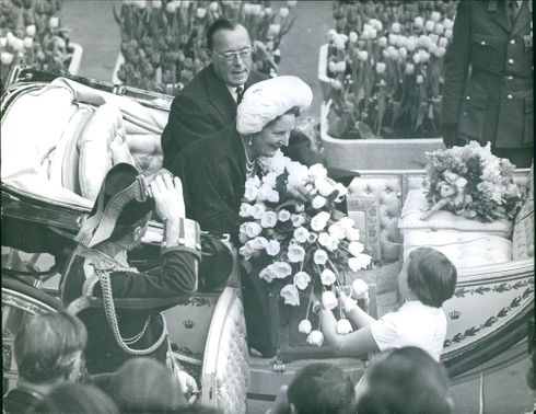 Juliana Beenland during was given a bouquet of flowers during the parade.
