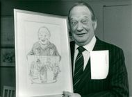 Carl-Gustaf Lindstedt with a caricature of himself