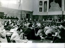 People siting in the courtroom. 1962