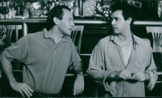 """A photo of Ray Liotta as Ryan Weaver and producer David Valdes in the film """"Turbulence"""". 1997."""