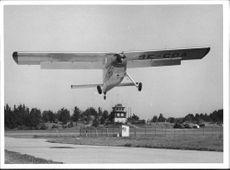 An Helio Courier plane at the airfield.