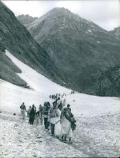 Refugees are crossing mountains with their family. 1967