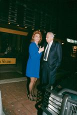 Sophia Loren arrives at a cocktail party, here with Dr. Rosenbar