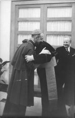 Pope Paul VI greeting a man.