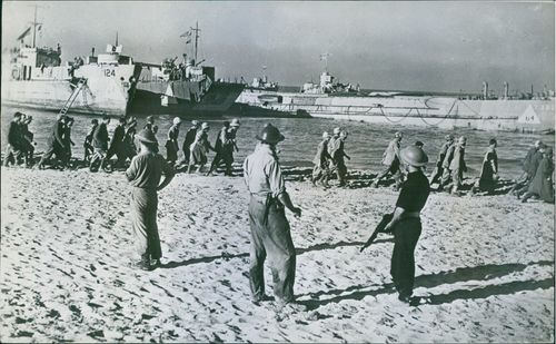 Italian soldiers marching along the water edge, 1943.