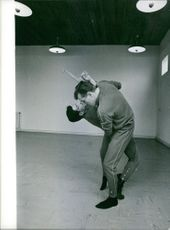 A photo of men practice self defense during an activity.