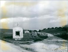 A chapel situated in a vast farmland.