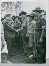 1946 First International Boy Scouts Camp in Milan General Dunlop shaking hands with one of the Rover scouts, at the first international Boy Scouts, camp at Milan.