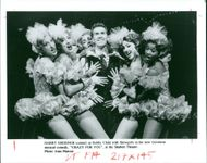 Harry groener as bobby child with showgirsls in the new gershwin musical comedy.