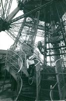 Bernard Munier rode a unicyle down the 1,700 steps and landings of the Eiffel Tower non-stop without touching a rail with his hands or a step with his feet being held by stirrups to the pedals. 1971