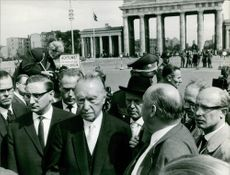 Konrad Adenauer surrounded with people.