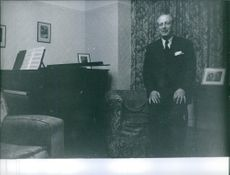 Maurice Harold Macmillan standing in home. 1953