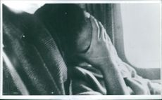 A woman sleeping in a vehicle while her covering her face with her hand.  Taken - Circa 1965