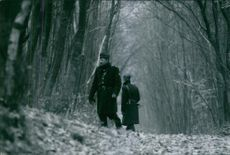 1967 A photo of Police searching in the forest for the body of kidnapped victim Emmanuel Maillart.