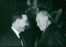 Konrad Adenauer talking to man.