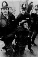 Protestors resist non-violently as police arrest them during a blockade of the Greenham Common U.S. Air Force Base