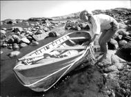 The author, Tove Jansson, puts the boat in the water at the Pellinge archipelago