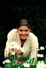 Crown Princess Victoria pickes daisies in the garden at Solliden during her 21st birthday.